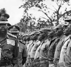 Gen. Ojukwu, inspecting a guard of honour in Biafra